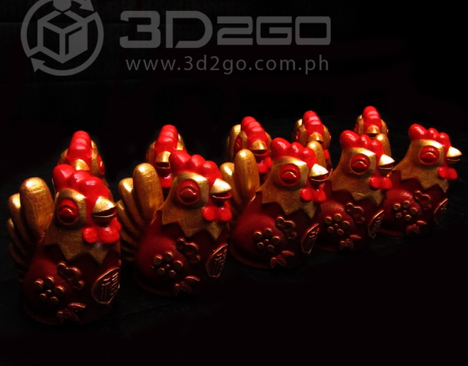 Golden fire roosters figurines